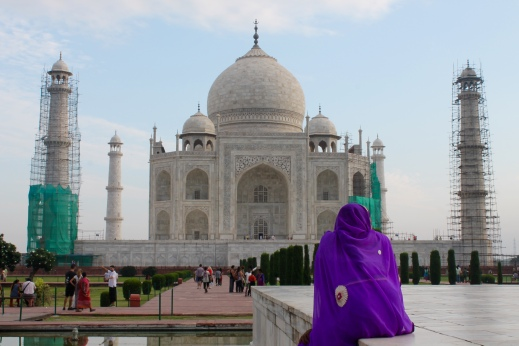 Woman admiring the Taj Mahal - early morning
